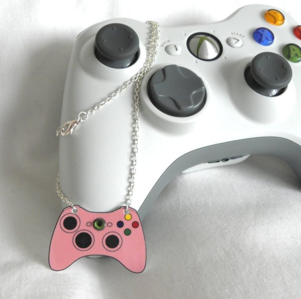 "Get pretty in pink with this <a href=""http://www.craftisart.com/85931/girl-gamer-pink-xbox-360-video-games-controller-necklac"