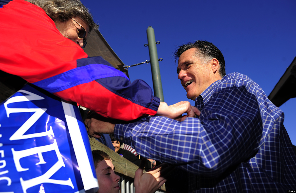 Republican presidential hopeful Mitt Romney greets supporters after holding a veterans rally in Pensacola, Florida, January 2