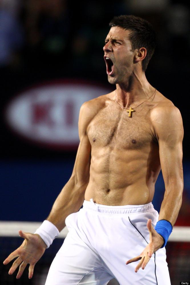 MELBOURNE, AUSTRALIA - JANUARY 29:  Novak Djokovic of Serbia celebrates winning championship point in his men's final match a