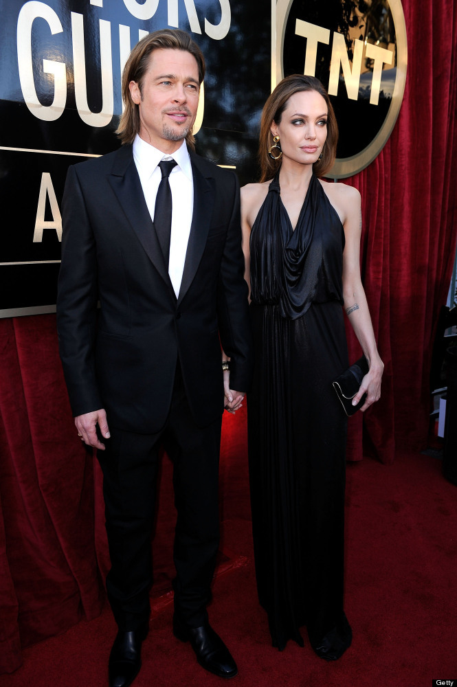LOS ANGELES, CA - JANUARY 29: Actors Brad Pitt (L) and Angelina Jolie arrive at the 18th Annual Screen Actors Guild Awards at