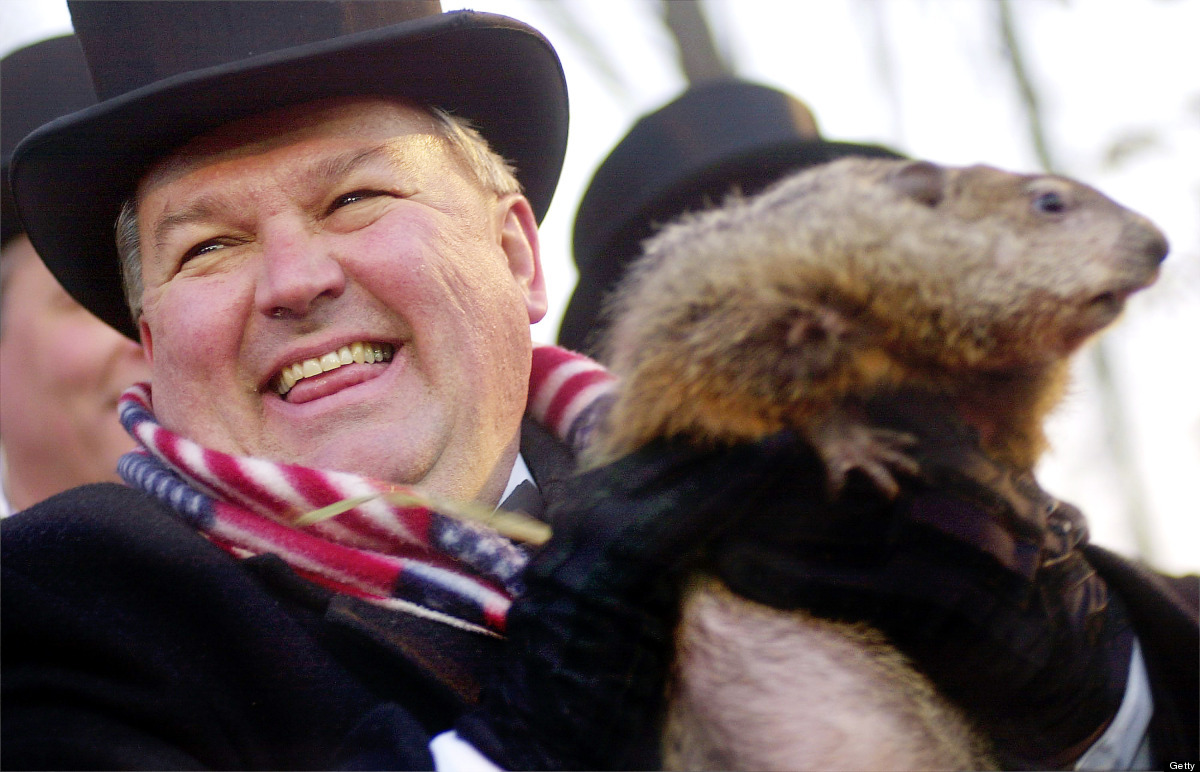Official Groundhog Handler Bill Deeley holds Punxsutawney Phil February 2, 2002 after the groundhog made his yearly weather p
