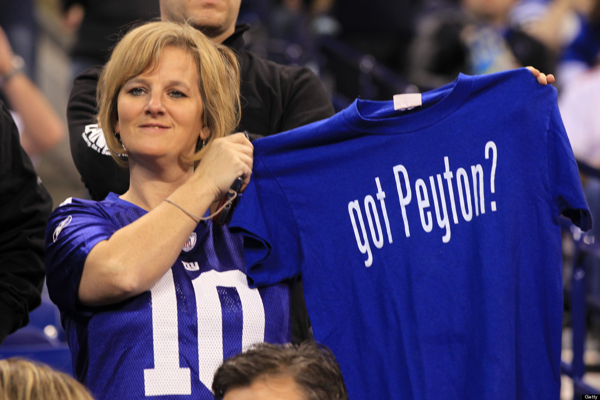 A fan holds up a t-shirt which reads 'got Peyton' in reference to quarterback Peyton Manning of the Indianapolis Colts during
