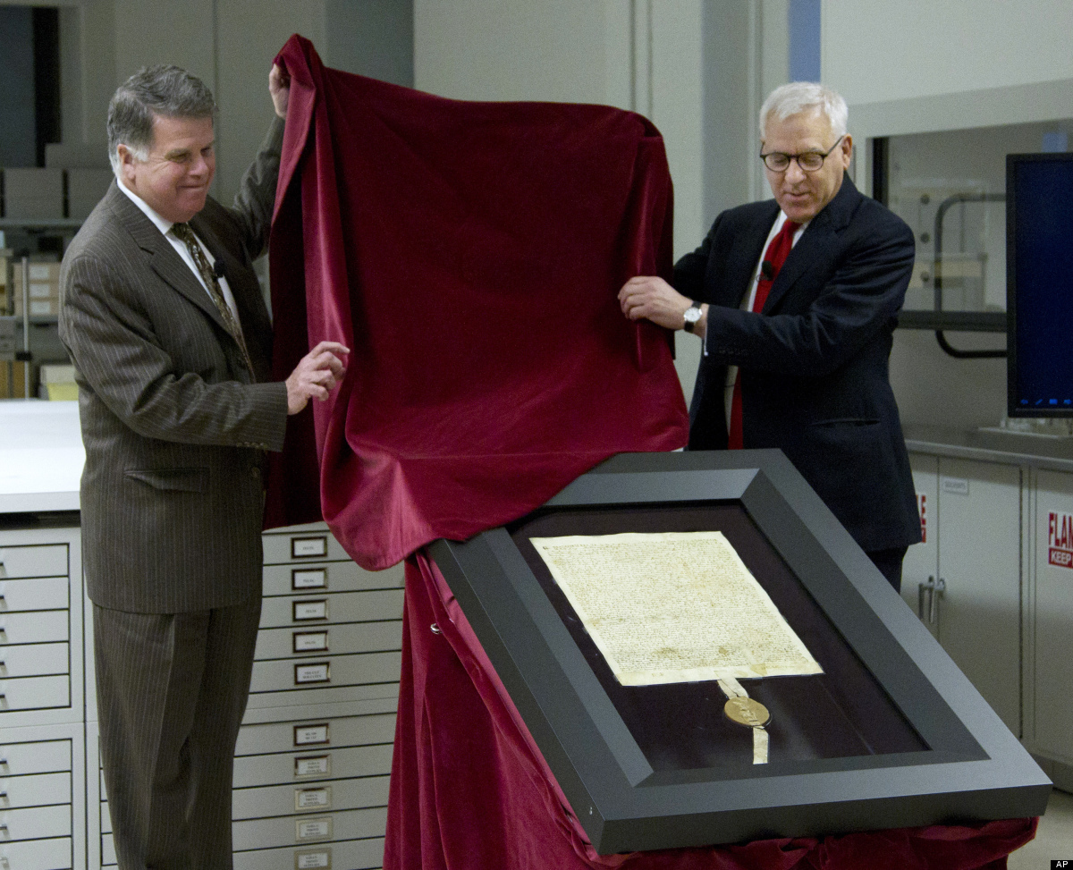 Carlyle Group co-founder and Magna Carta owner David Rubenstein, right, and Archivist of the U.S. David Ferriero, unveil the