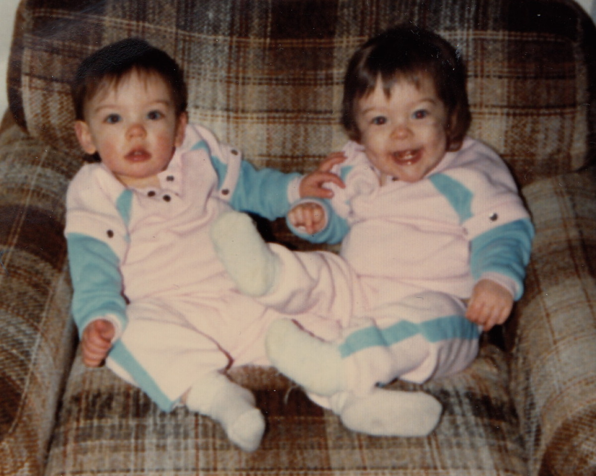 In our matching baby outfits; probably about to get into some kind of trouble.
