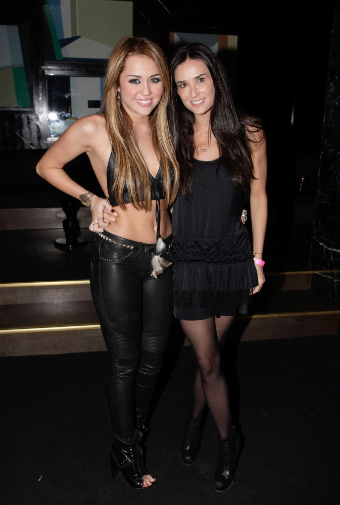 Singer Miley Cyrus (L) and actress Demi Moore attend Miley Cyrus' 18th Birthday Party at Trousdale on November 21, 2010 in We