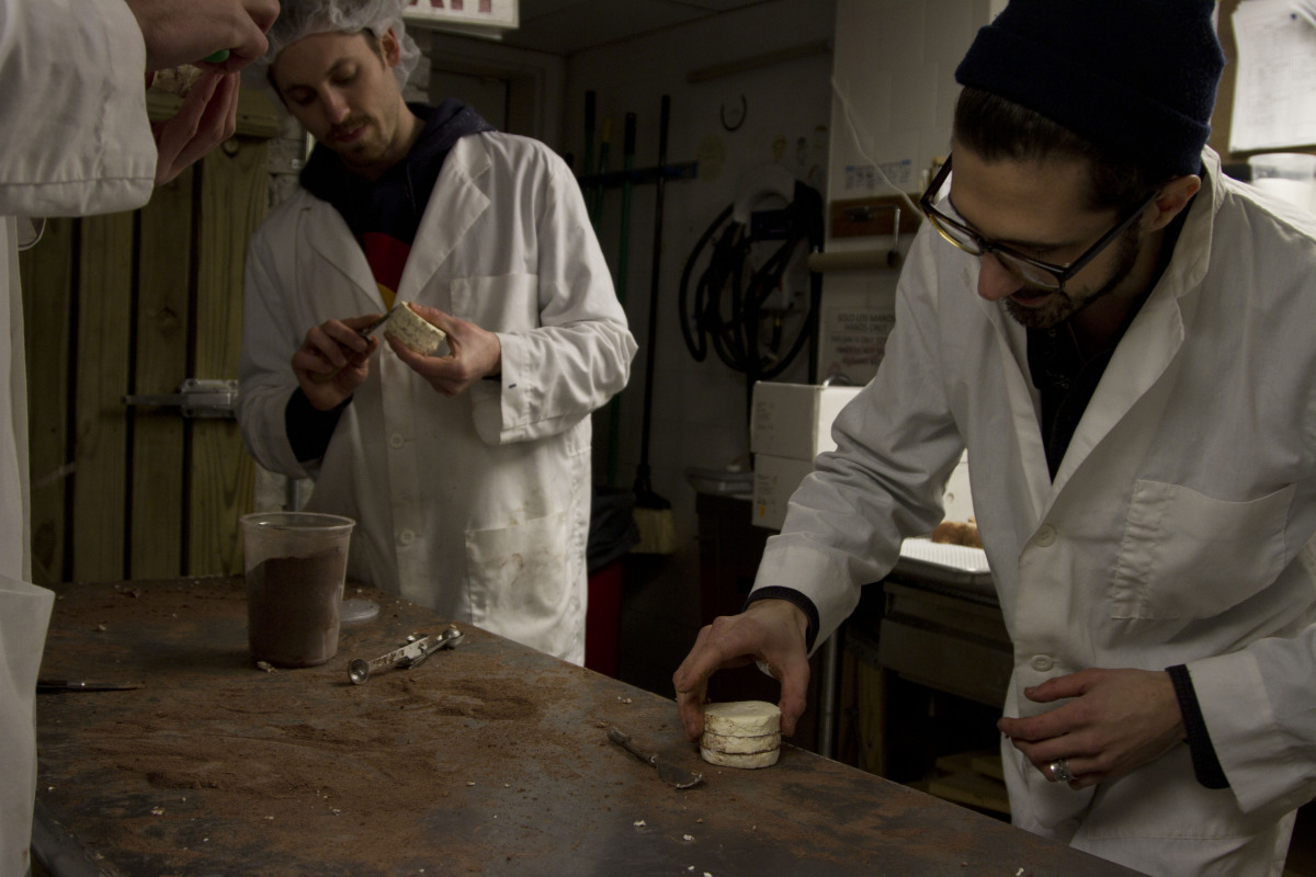 Ralph, at back, and Derek Herbster of Mast Brothers, at right, assemble wheels of Love at Mast.