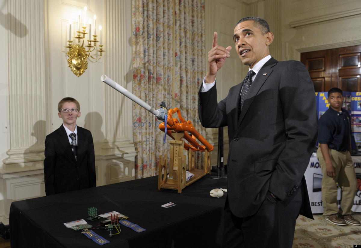President Barack Obama watches as a marshmallow is launched by a gun designed by Joey Hudy of Phoenix, Ariz., Tuesday, Feb. 7