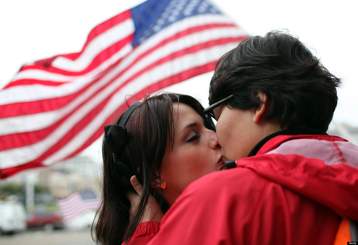 Same-sex couple Breana Hansen (L) and Monica Chacon kiss as they celebrate outside of San Francisco City Hall on February 7,