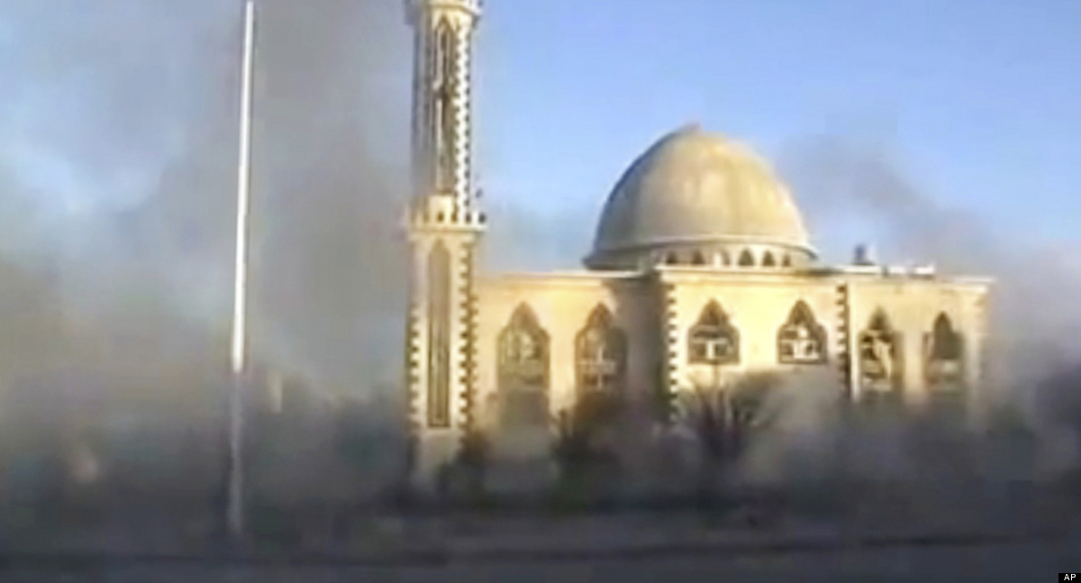 This image from amateur video made available by Shaam News Network on Thursday, Feb. 9, 2012, purports to show smoke filling