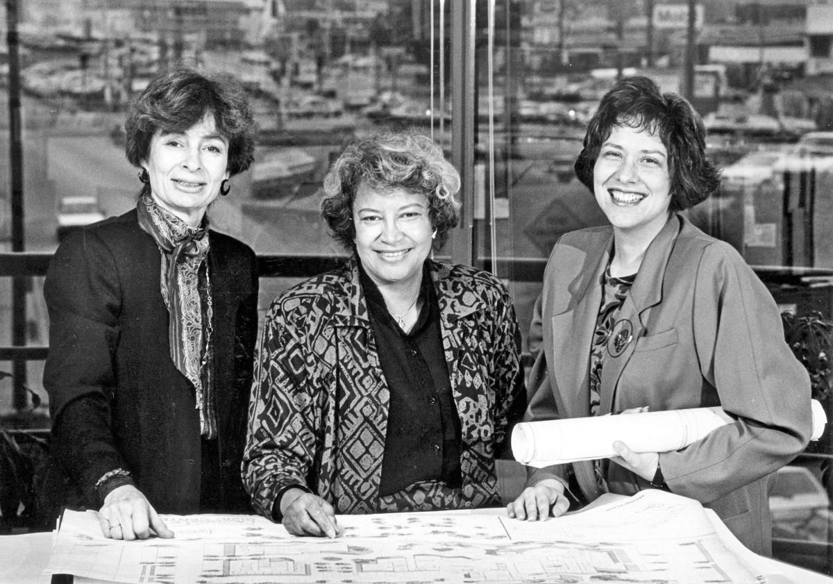 A 1986 staff file photo of architects, from left, Margot Siegel, Norma Sklarek and Katherine Diamond, looking over blueprints