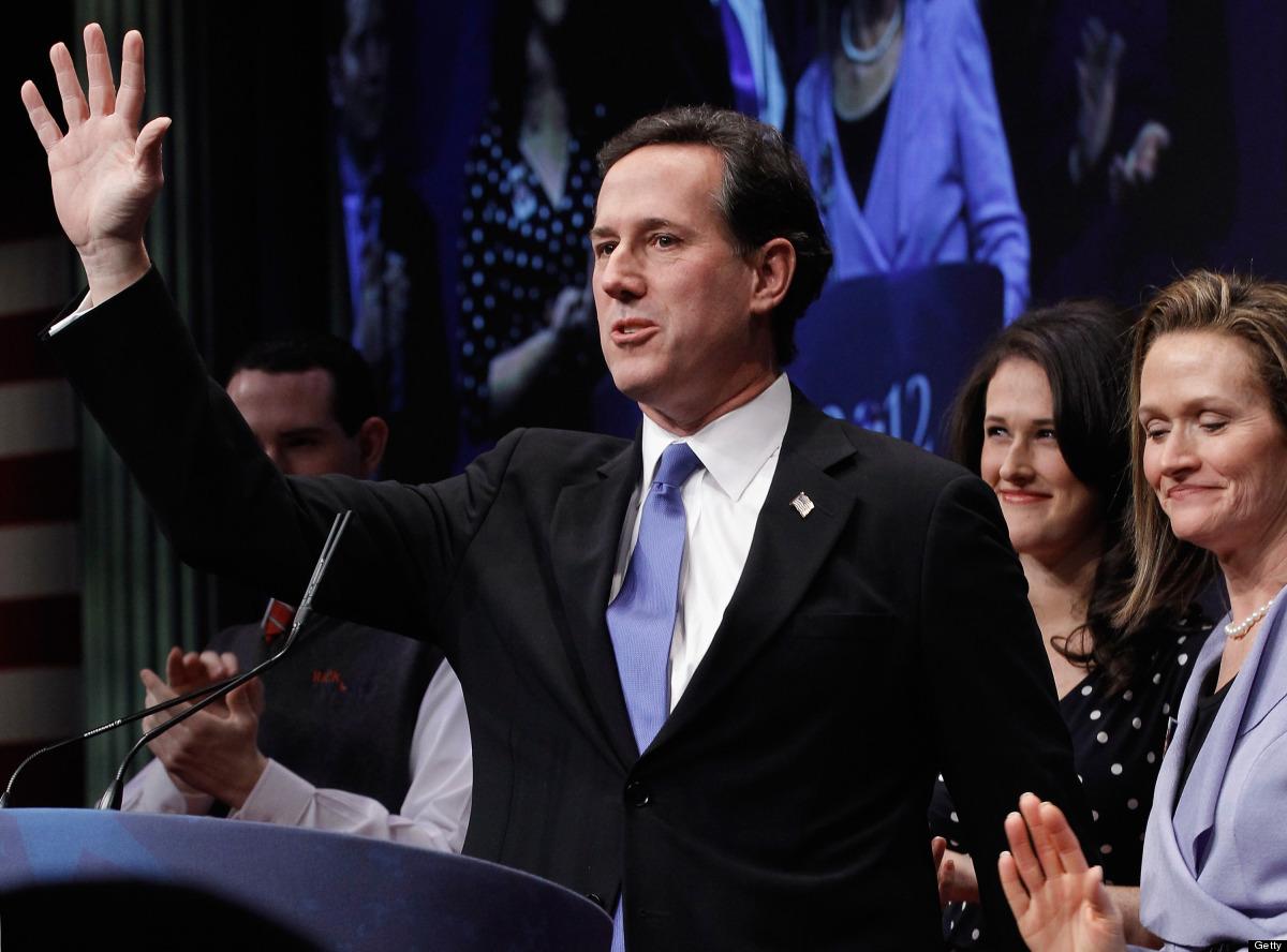 Republican presidential candidate and former U.S. Senator Rick Santorum is joined on stage by his wife Karen Santorum (R) and