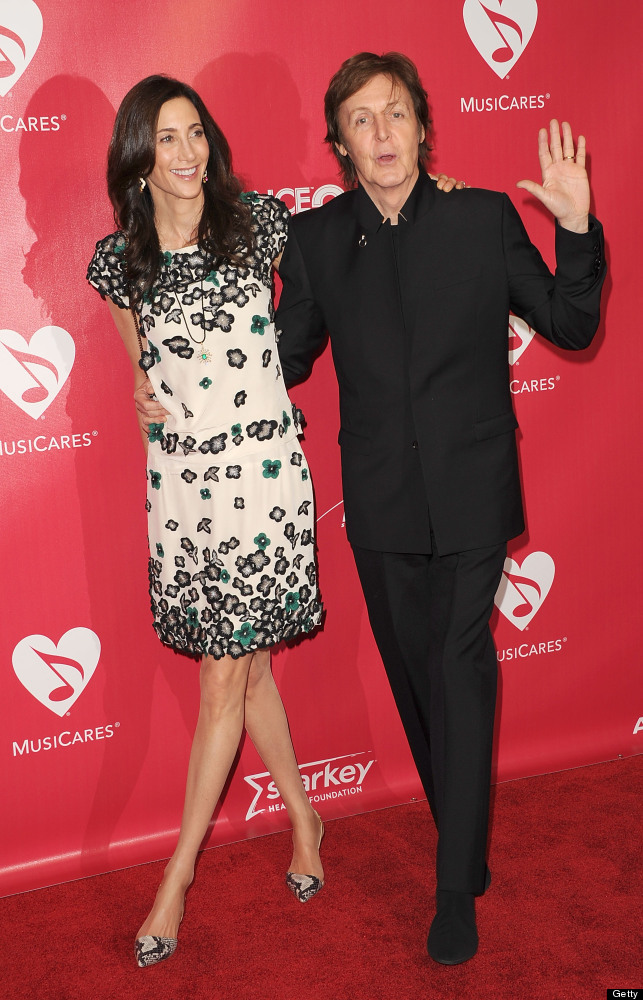 Honoree Sir Paul Mcartney (R) and Nancy Shevell arrive at the 2012 MusiCares Person of the Year Tribute to Paul McCartney hel