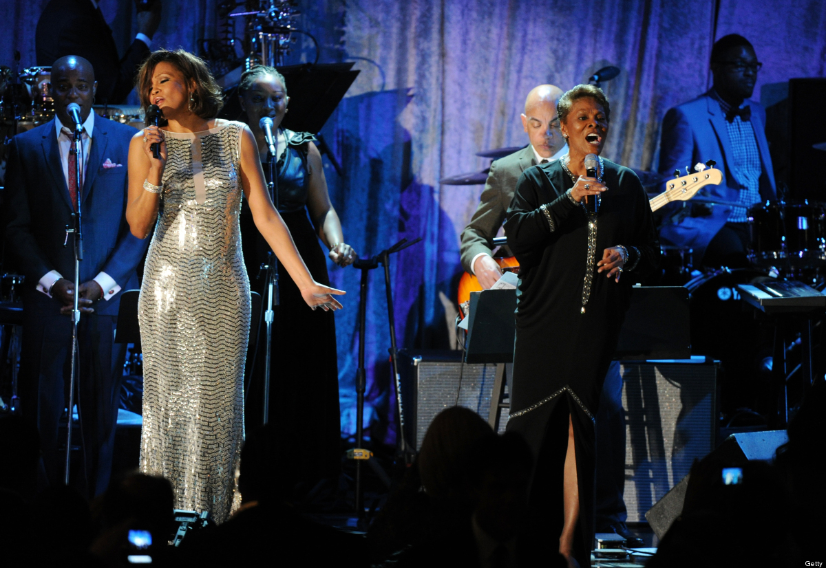 Singers Whitney Houston (L) and Dionne Warwick perform onstage during the 2011 Pre-Grammy Gala & Salute to Industry Icons, wi