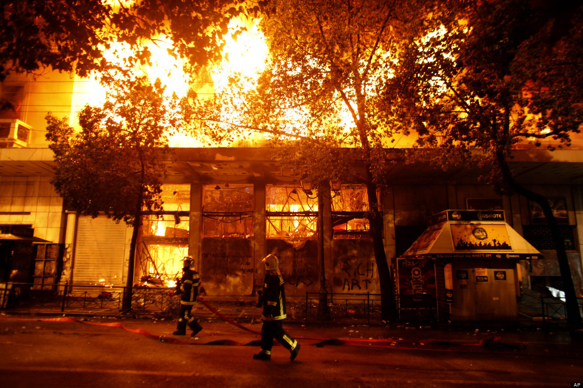 A cinema burns in Athens, Sunday, Feb. 12, 2012. Riots engulfed central Athens and at least 10 buildings went up in flames in