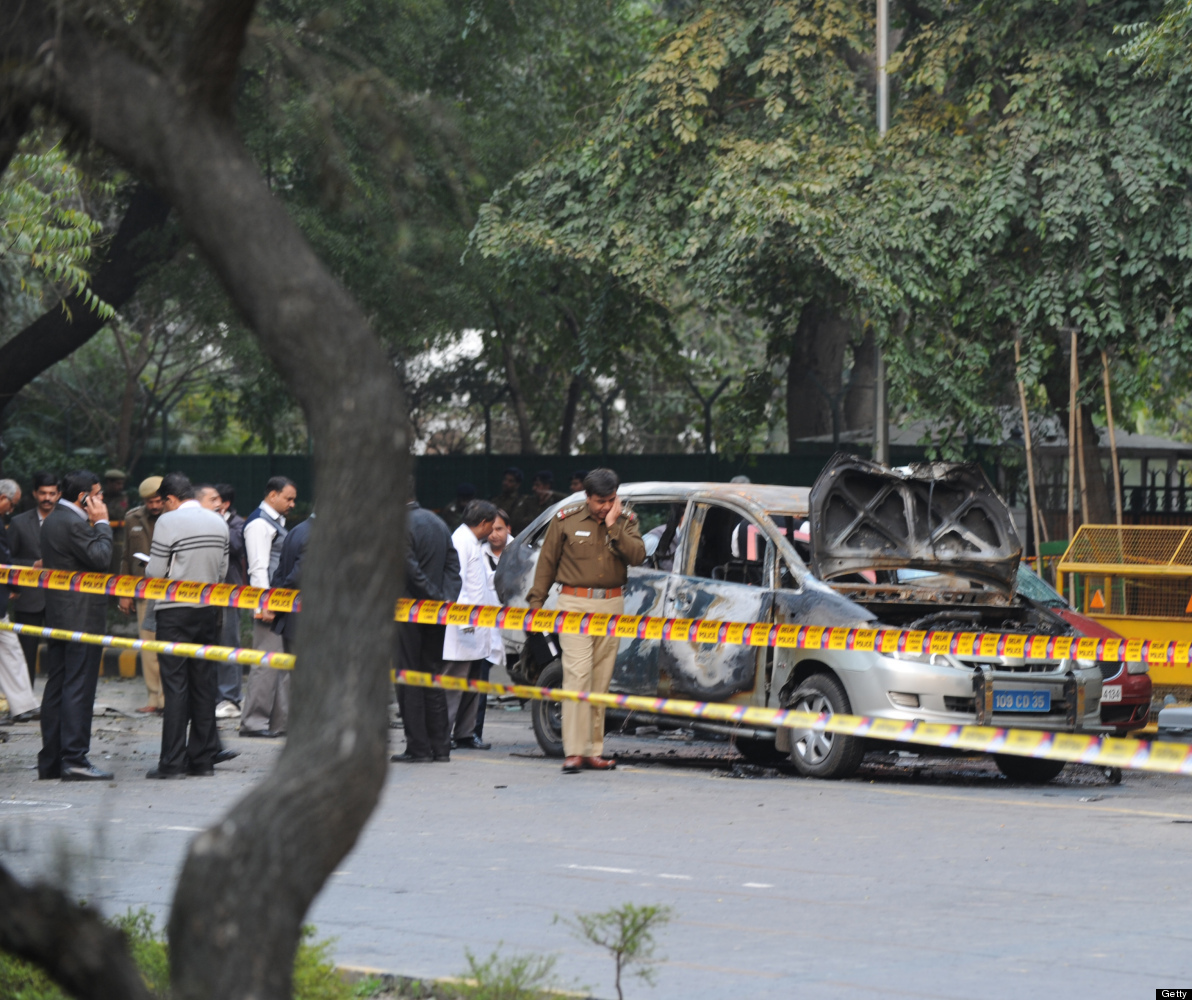 Investigators work the scene of a vehicle that exploded near the Israeli embassy in New Delhi on February 13, 2012.  An Israe