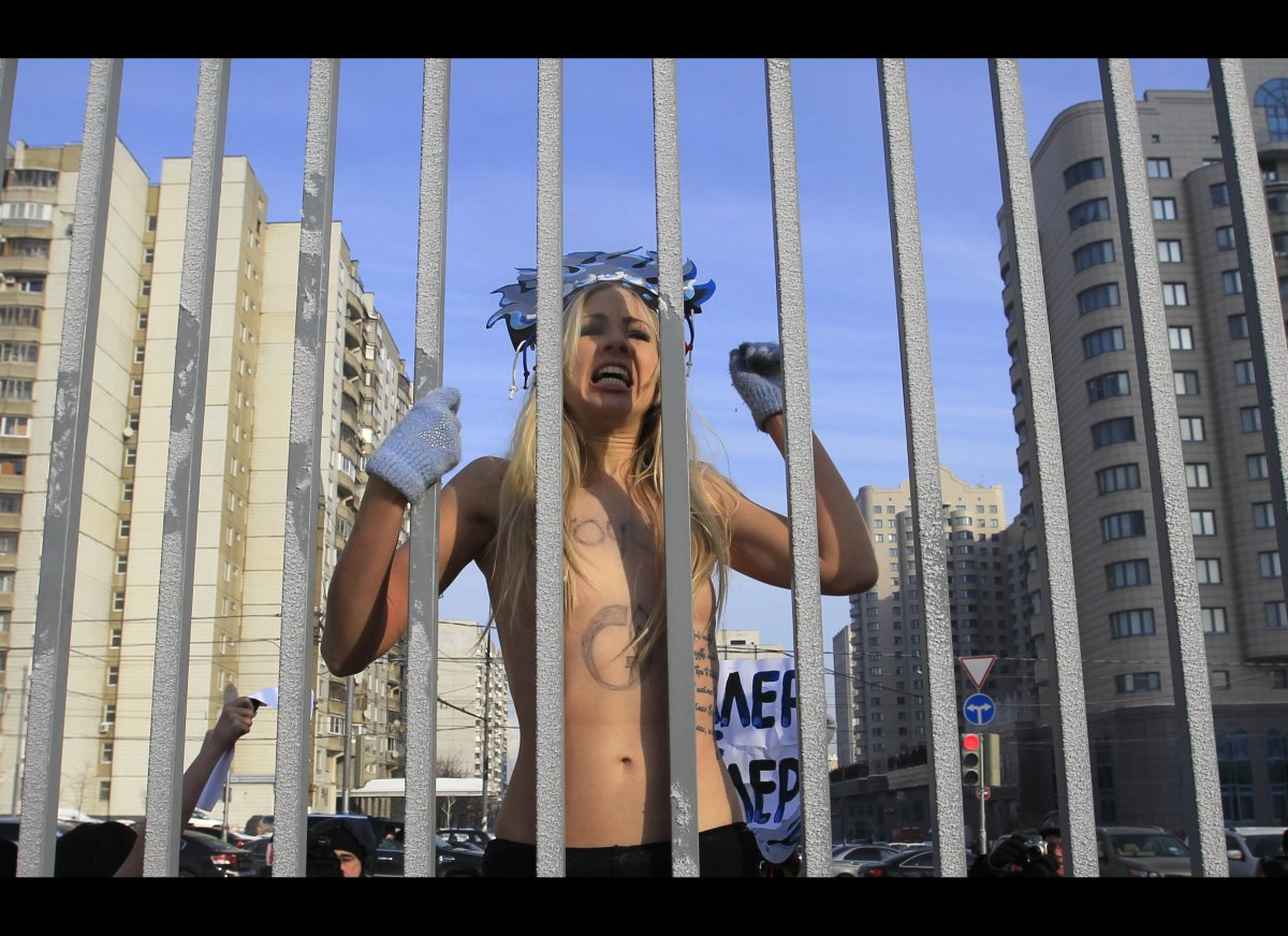 A Femen activist stages a protest outside Gazprom headquarters, Moscow, Monday, Feb., 13, 2012. Activists of the Ukrainian gr