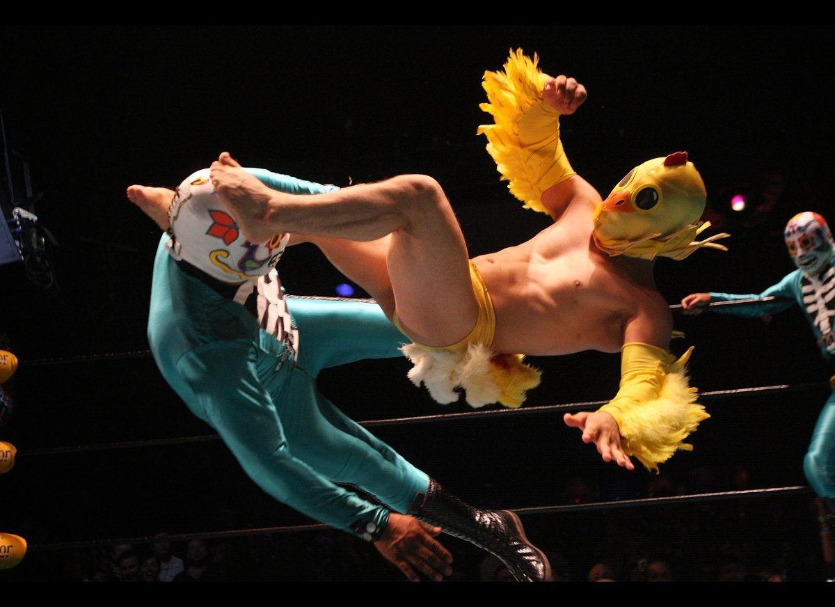 LOS ANGELES, CA - MAY 05:  Lil Chicken and one of Los Cavaleras luchadores, traditional Mexican wrestlers, perform at the Luc