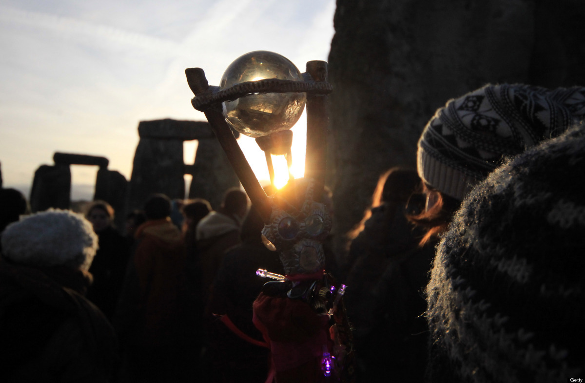 WILTSHIRE, ENGLAND - DECEMBER 22:  Druids, pagans and revellers take part in a winter solstice ceremony at Stonehenge on Dece
