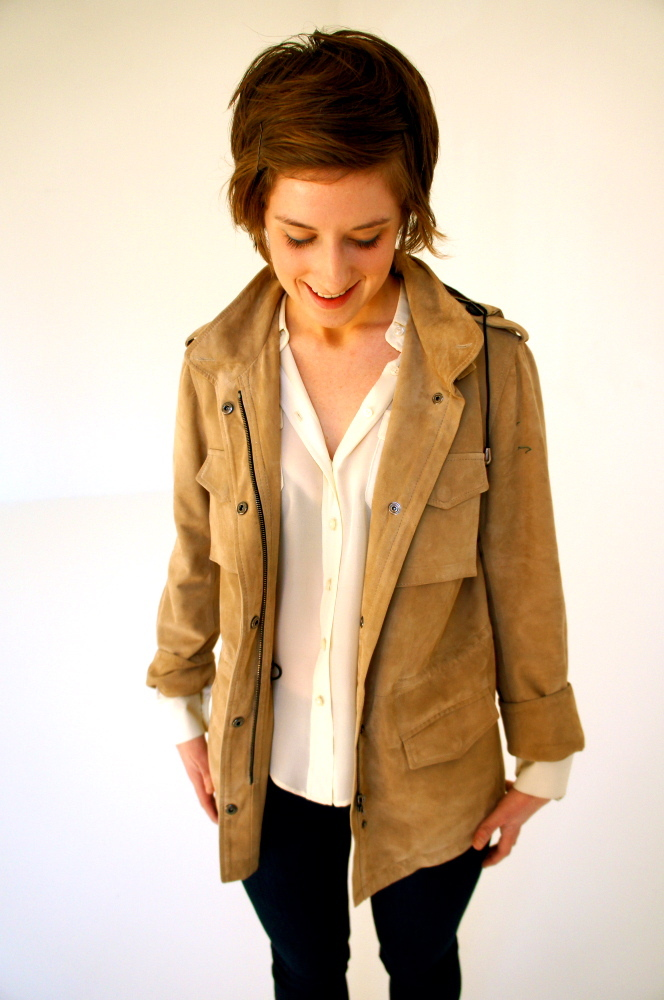 Holmes & Yang Assistant Designer Laura Kadamus models a white Holmes & Yang Camp Blouse, in cream silk georgette; a signature