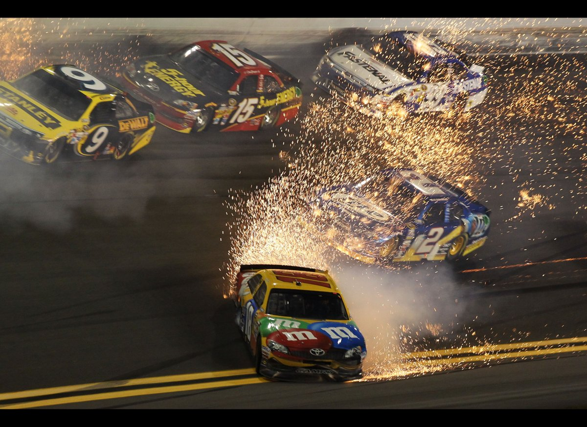 Kyle Busch, driver of the #18 M&M's Brown Toyota, crashes during the NASCAR Budweiser Shootout at Daytona International Speed
