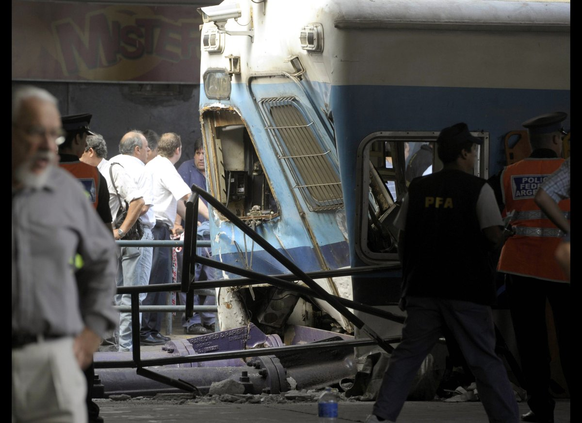 Police and rescue workers surround a train that crashed at Once train station in Buenos Aires on February 22, 2012. At least