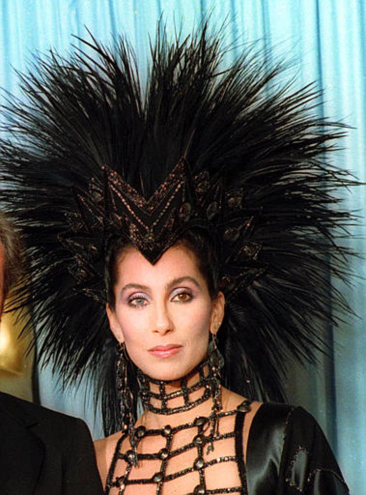 Cher stepped out wearing this headpiece by designer Bob Mackie, but she may have been better off in one of her iconic wigs. P