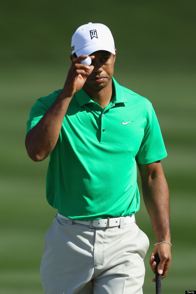 MARANA, AZ - FEBRUARY 22:  Tiger Woods waves to fans on the third green during the first round of the World Golf Championship