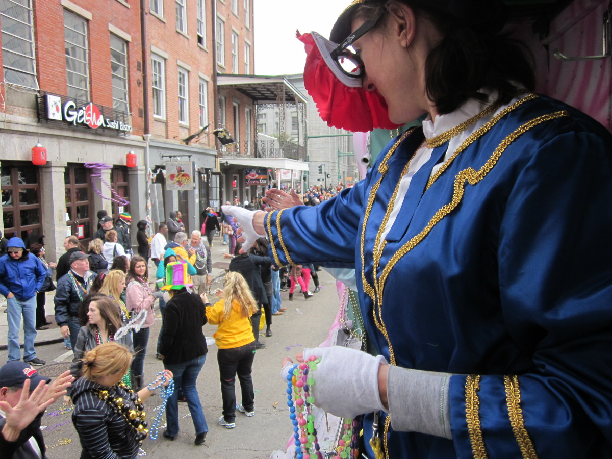 Sabrina Canfield, tossing beads to the crowd at the Krewe of Iris Mardi Gras parade last Sunday, February 19th.