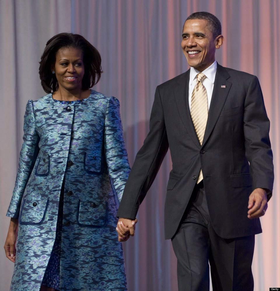 US President Barack Obama and First Lady Michelle Obama arrive for the groundbreaking ceremony for the Smithsonian National M
