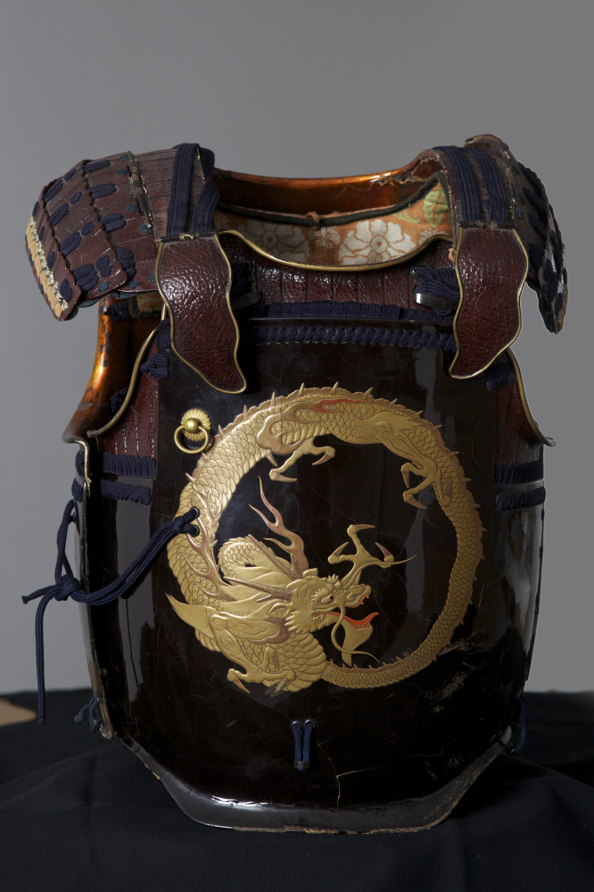 "This chest plate with the crouching dragon design has the inscription ""tatenashi-no-yoroi,"" on the interior meaning armor tha"