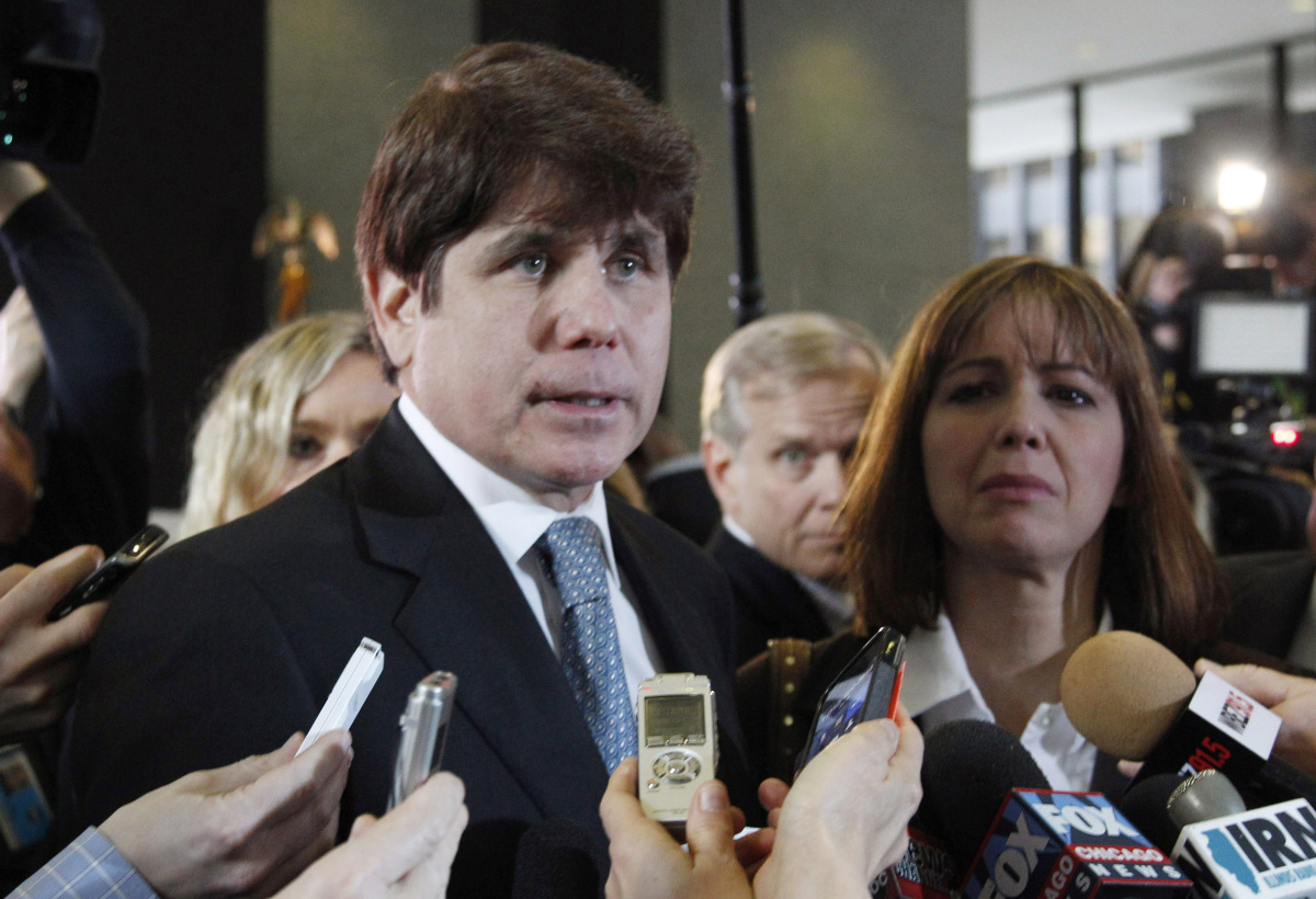 In this Dec. 7, 2011 file photo, former Illinois Gov. Rod Blagojevich speaks to reporters as his wife Patti looks on at the f