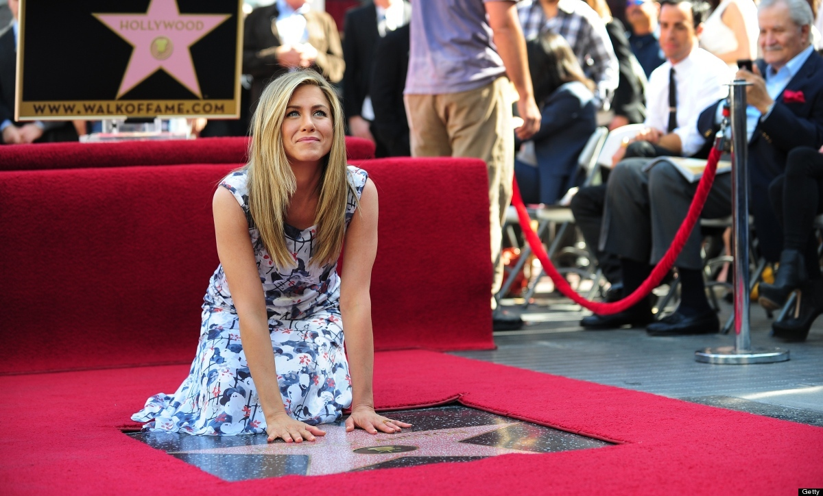 Actress Jennifer Aniston touches her just unveiled Star on Hollywood's Walk of Fame on February 22, 2012 in Hollywood, Califo