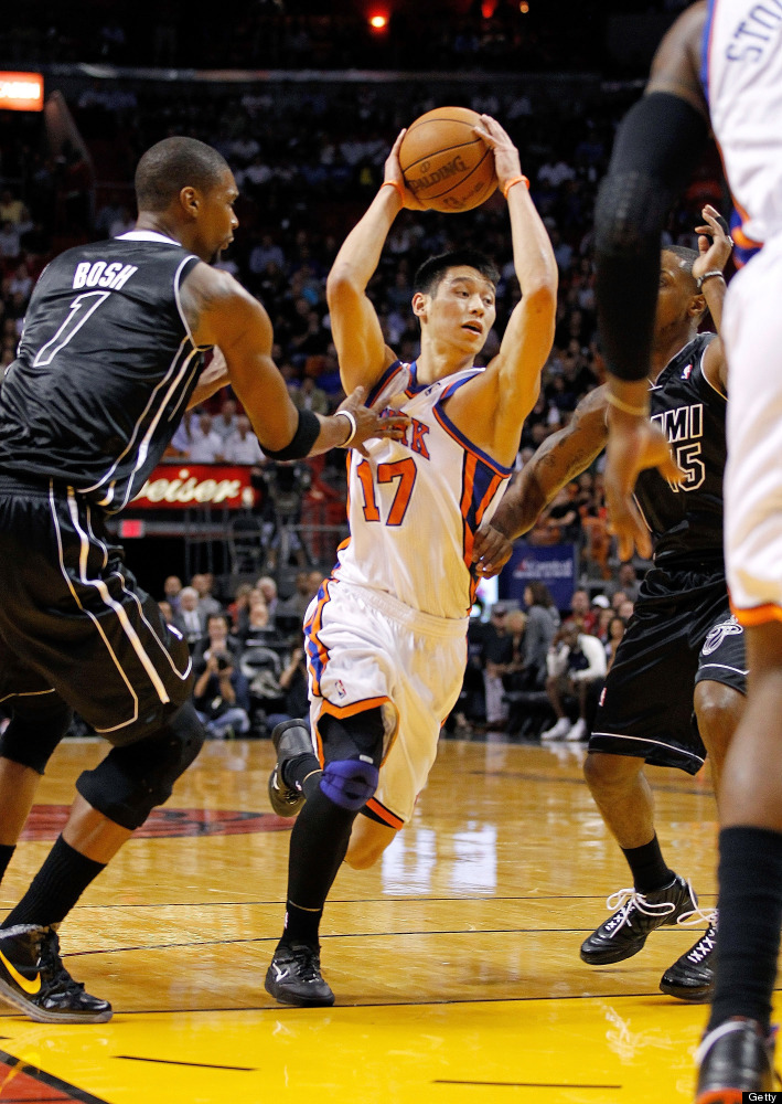 MIAMI, FL - FEBRUARY 23:  Jeremy Lin #17 of the New York Knicks drives against Chris Bosh #1 of the Miami Heat during a game