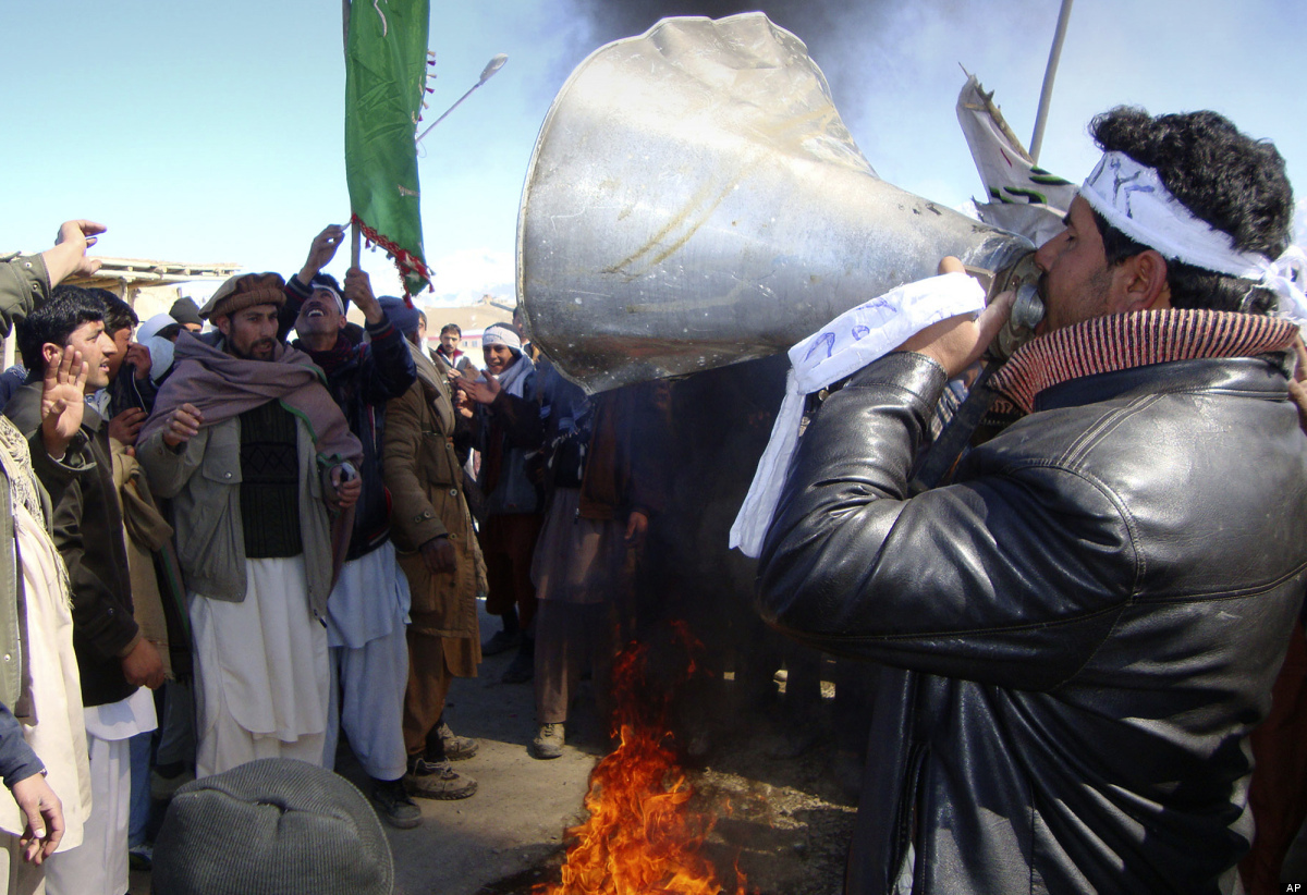 An Afghan uses a bullhorn during an anti-U.S. demonstration in Khushi, Logar province south of Kabul, Afghanistan, Thursday,