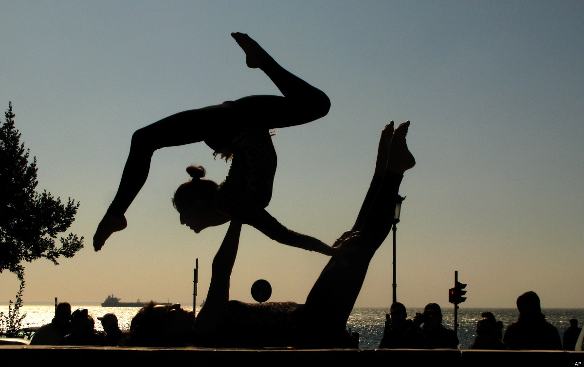Dancers perform an an outdoor event on the seafront, in the northern Greek city of Thessaloniki, on Friday, Feb. 24, 2012. Ca