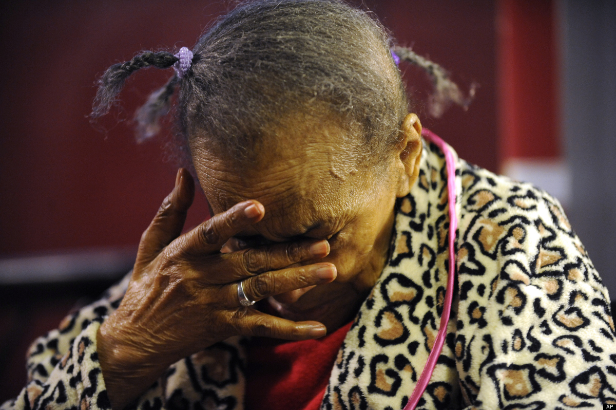 In this Oct. 3, 2011 photo, Texana Hollis, 101, reacts after discussing her eviction in Detroit. Hollis was evicted from her