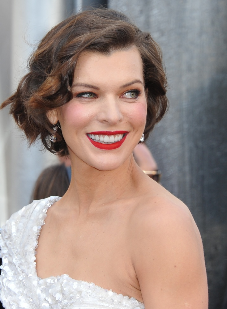 Jovovich is the epitome of ladylike in this soft, elegant up-do. Getty