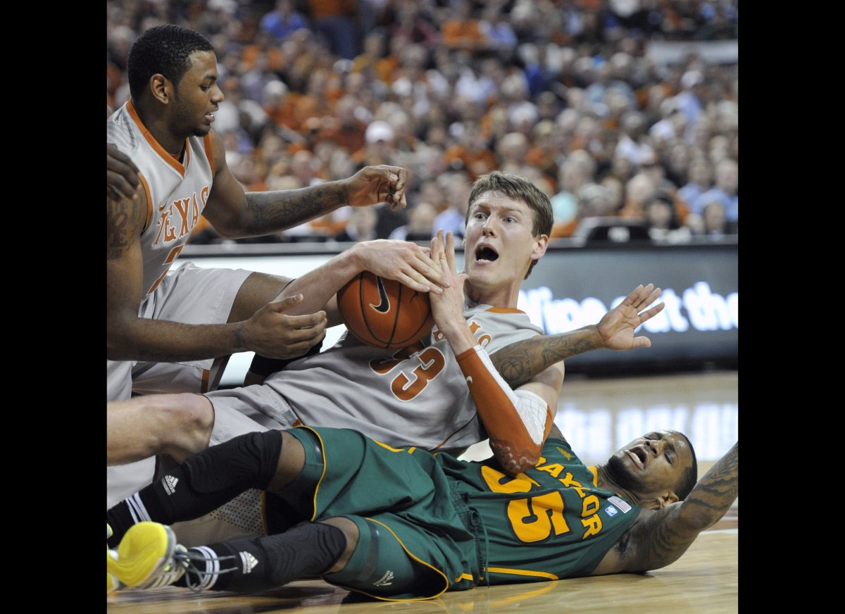 Texas center Clint Chapman, center, asks for a timeout after coming up with a loose ball between Baylor guard Pierre Jackson,