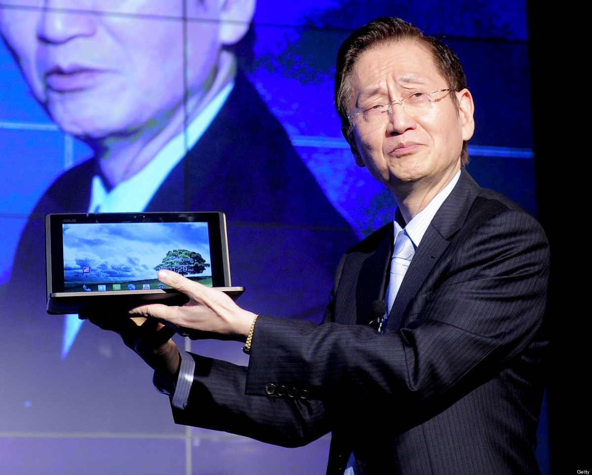 Chairman of the Chinese company Asus, Jonney Shih presents the Padfone during a press conference in Barcelona on February 27,