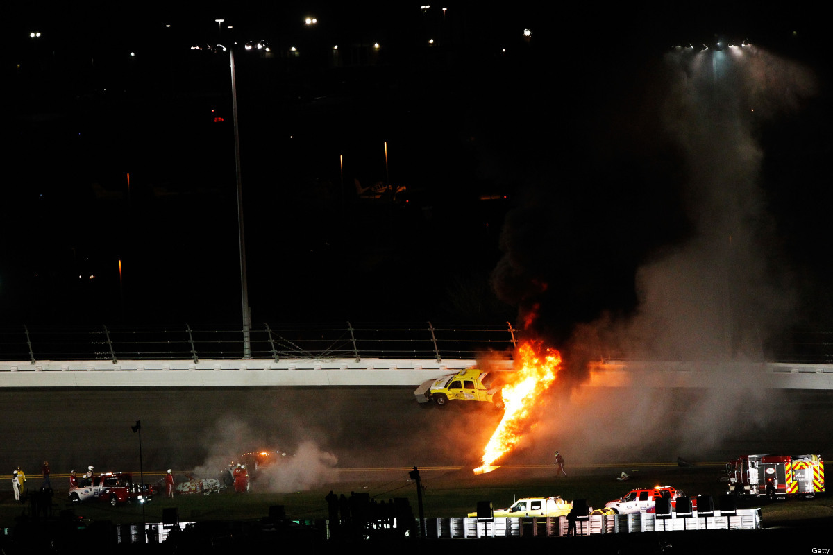A jet dryer bursts into flames after being hit by Juan Pablo Montoya, driver of the #42 Target Chevrolet, under caution durin