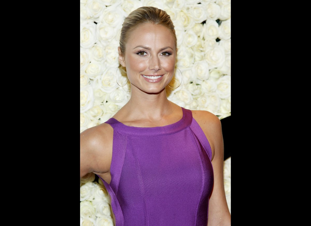 Way before she was dancing with the stars (and romancing George Clooney) 32-year-old Stacy Keibler was throwing her hat into