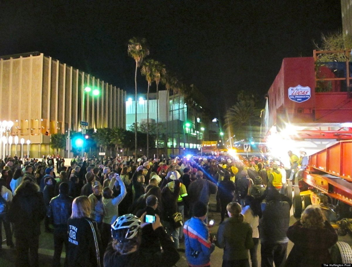 Fans rush the Rock Star to welcome it to LACMA.