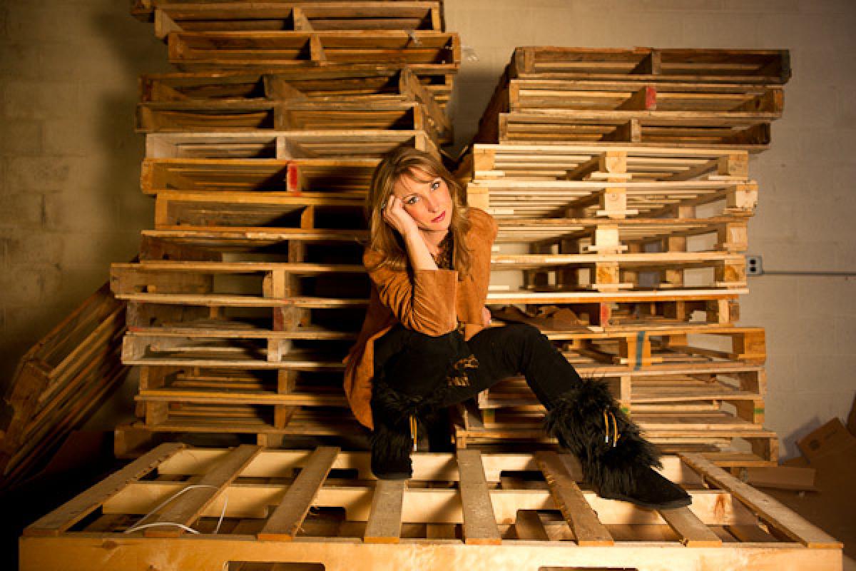 Deb Miller models her own black Sherpa Huggrz inside the company's warehouse.