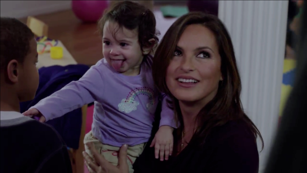 """Detective Benson holds a child in """"Law & Order: SVU."""""""