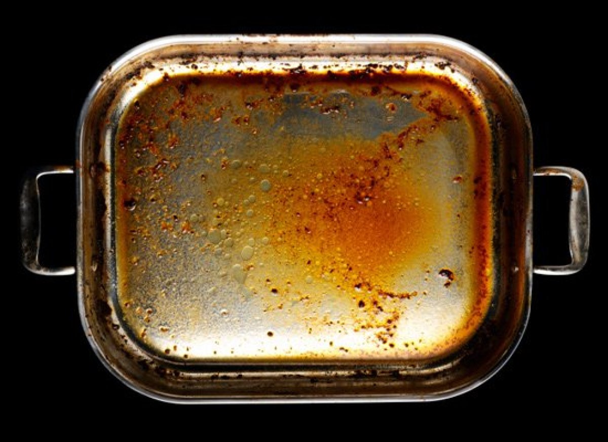 This should be pretty obvious. Grease, any oil or hot, liquid fat should not go down the garbage disposal let alone the drain