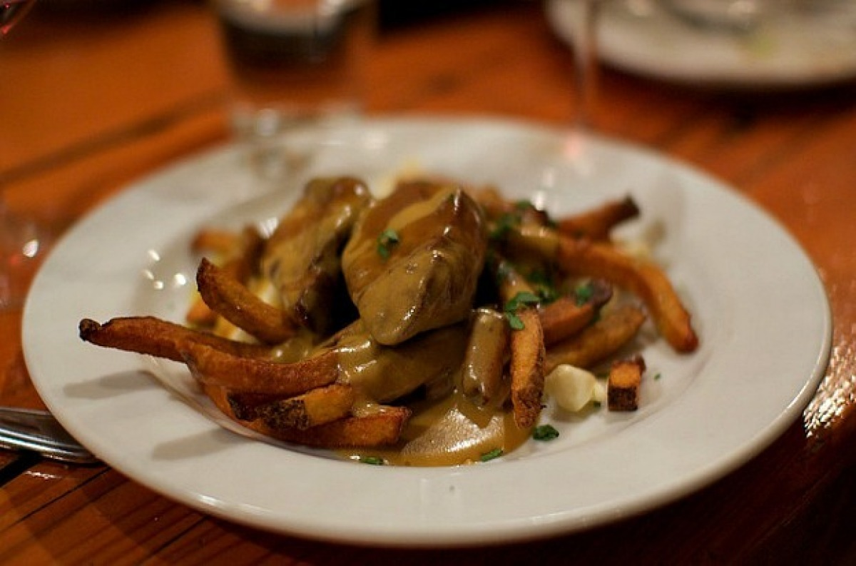At Montreal's beloved Au Pied de Cochon, already indulgent poutine gets another heaping helping of calories mixed with fat an