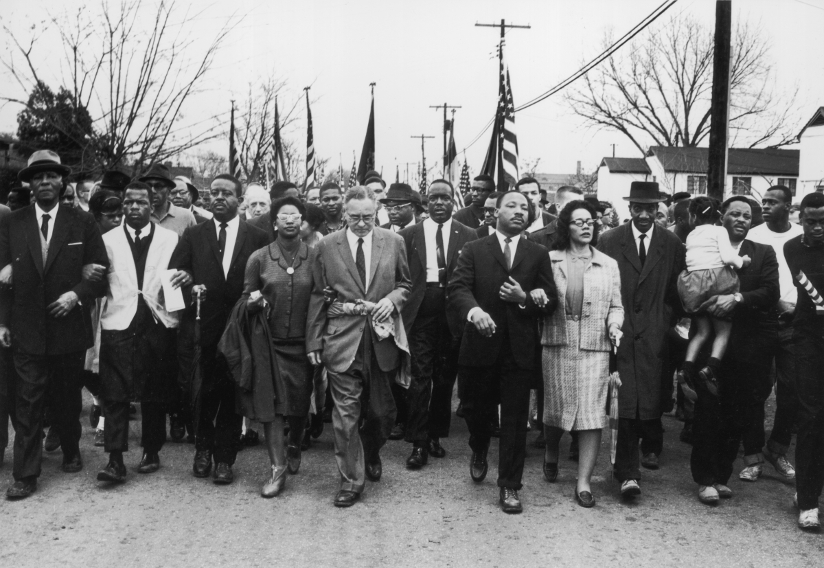 American civil rights campaigner Martin Luther King (1929  - 1968) and his wife Coretta Scott King lead a black voting rights