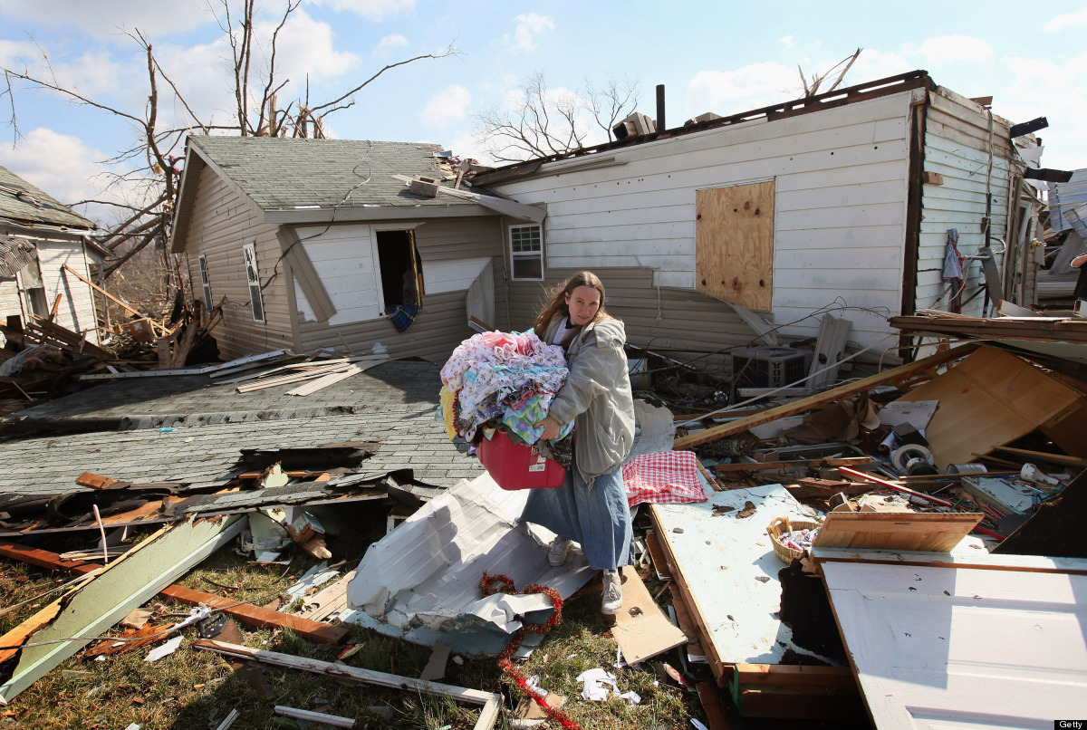 <em>From Getty:</em> HENRYVILLE, IN - MARCH 03: Rachel Wooley helps a friend rescue possessiona from her home after it was de