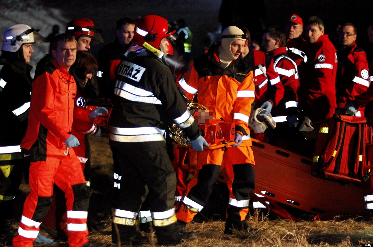 Rescuers carry an injured person at the scene of a train crash in Szczekociny near Zawiercie (Silesia) in Poland, on  March 4