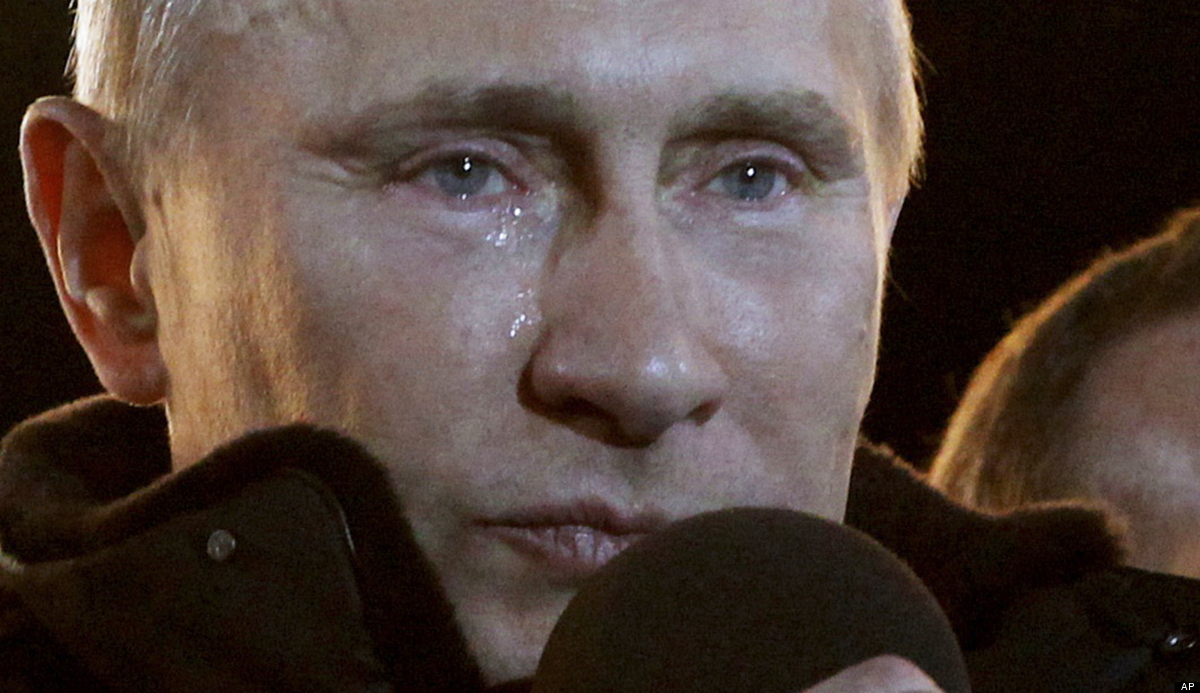 Russian Prime Minister Vladimir Putin, who claimed victory in Russia's presidential election, tears up as he reacts at a mass